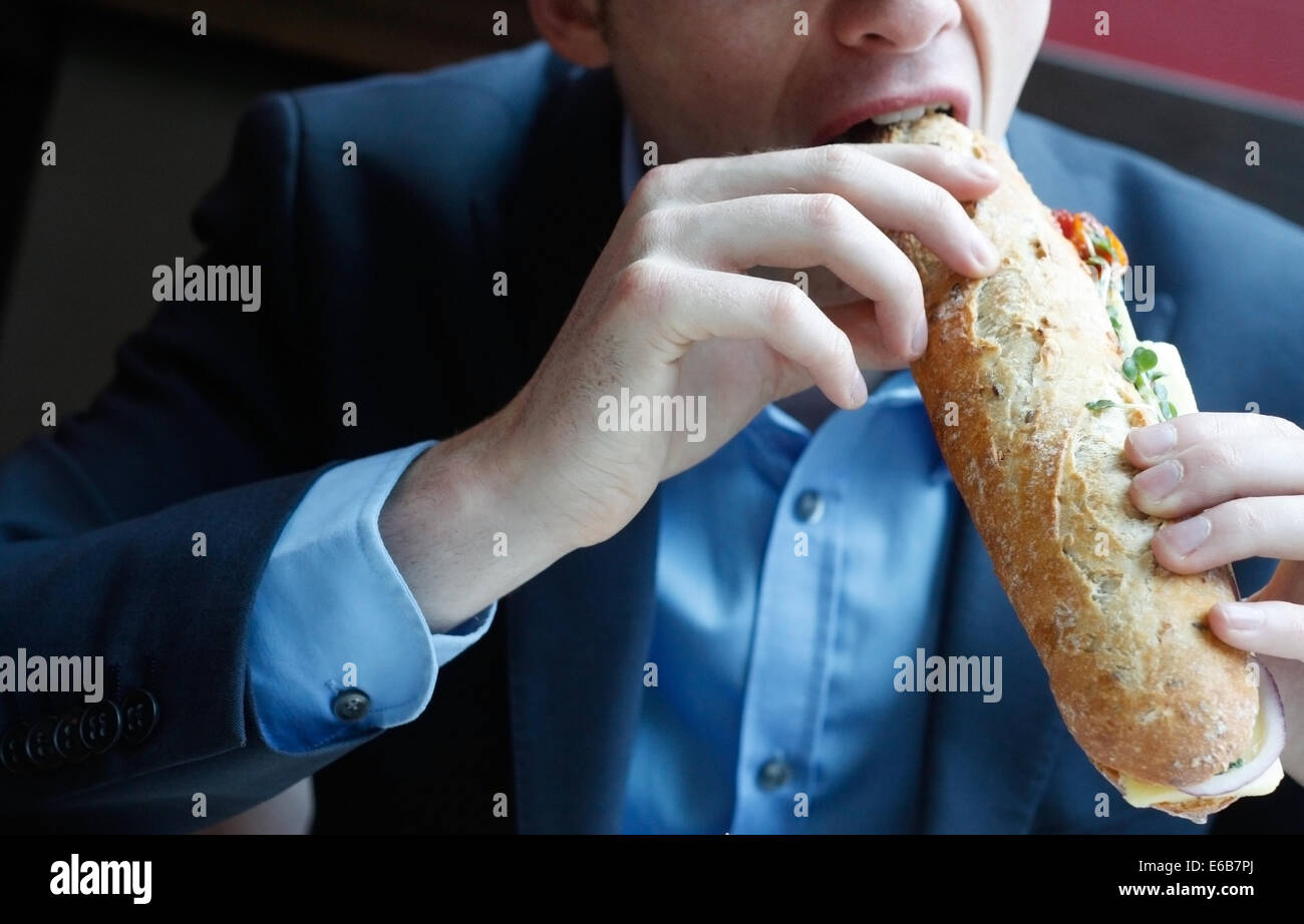 eating,sandwich,biting - Stock Image