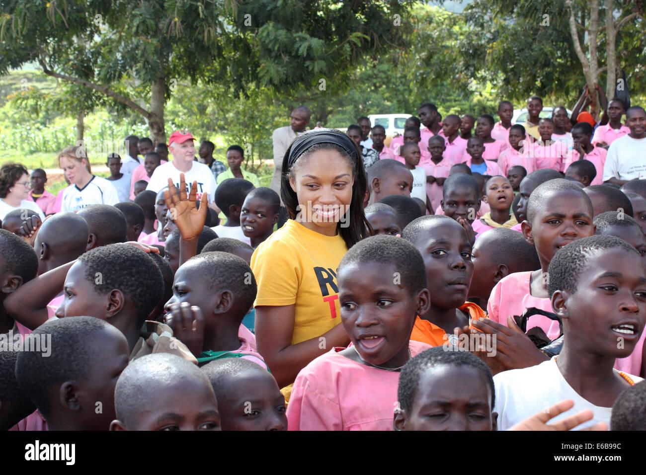 US athletics star Allyson Felix visits to disadvantaged children in school at Oruchinga refugee Settlement in Uganda - Stock Image