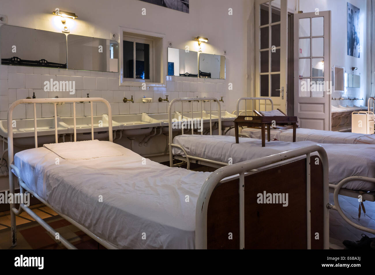 Hospital beds in the Dr Guislain Museum about the history of psychiatry in Belgium's first psychiatric hospital - Stock Image