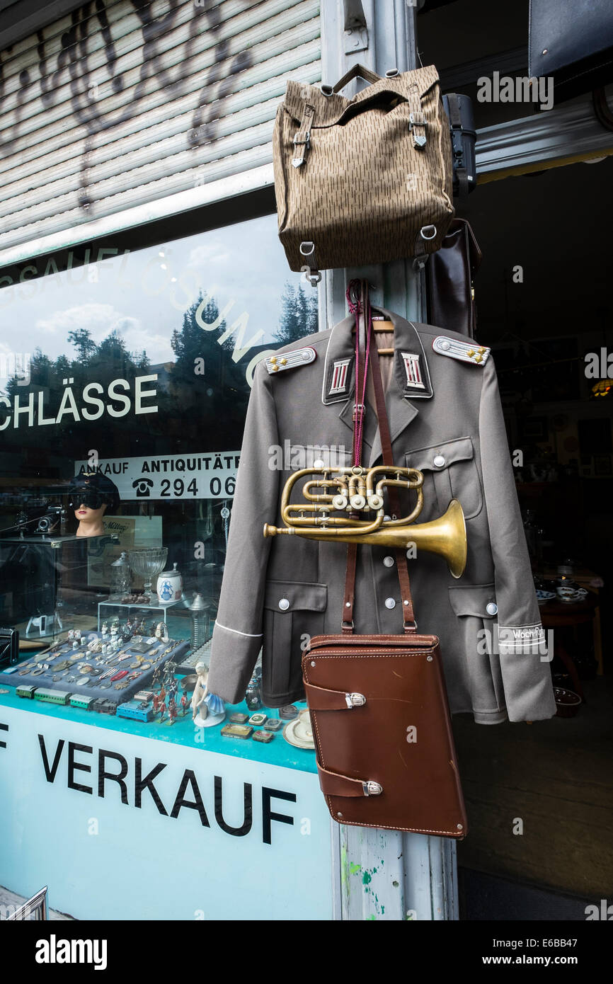 Antique shop selling military items in Friedrichshain district of Berlin Germany - Stock Image