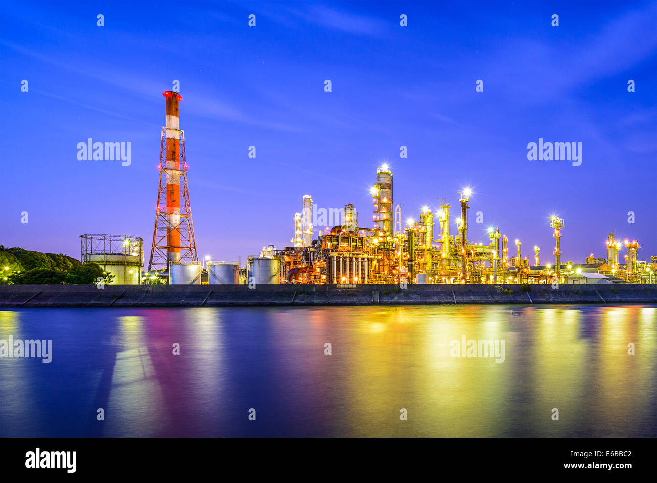 Oil refineries line a river in Yokkaichi, Japan. - Stock Image