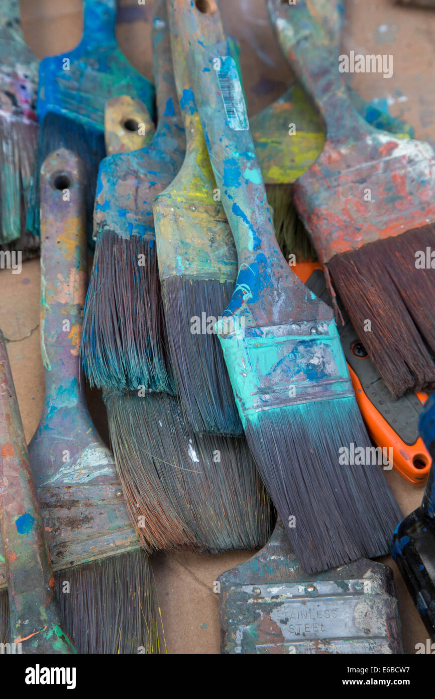 Detroit, Michigan - Paint brushes on a table where volunteers were painting a mural on the entrance to Cody High - Stock Image