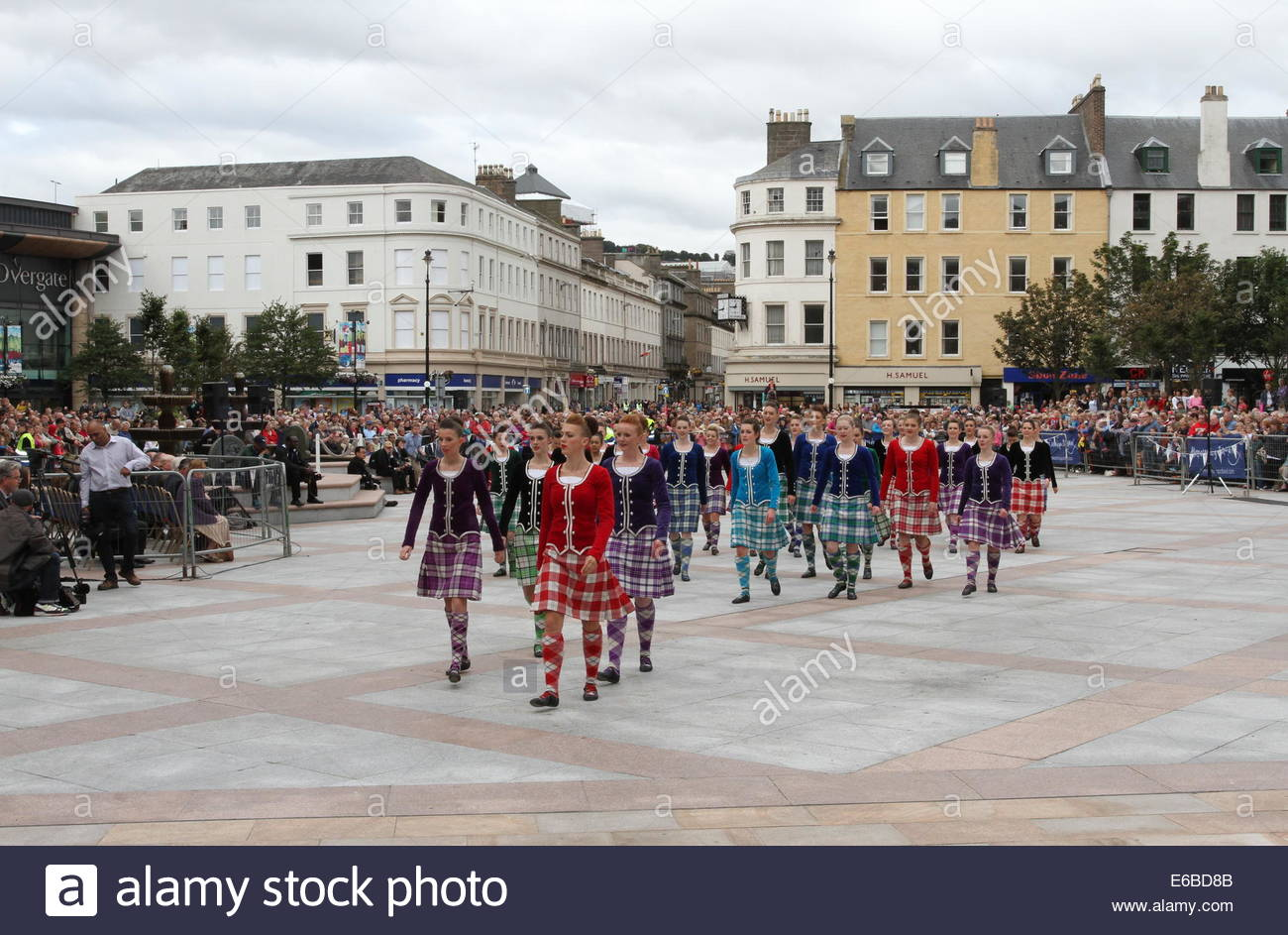 Dundee, Scotland, UK. 19th August, 2014.Highland dancers arrive in City Square Dundee. Hundreds of performers of - Stock Image
