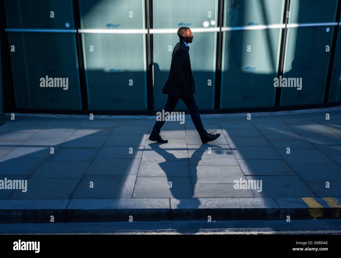 London, UK. 19th August, 2014.  a man in the City of London at sunset Credit:  Piero Cruciatti/Alamy Live News - Stock Image