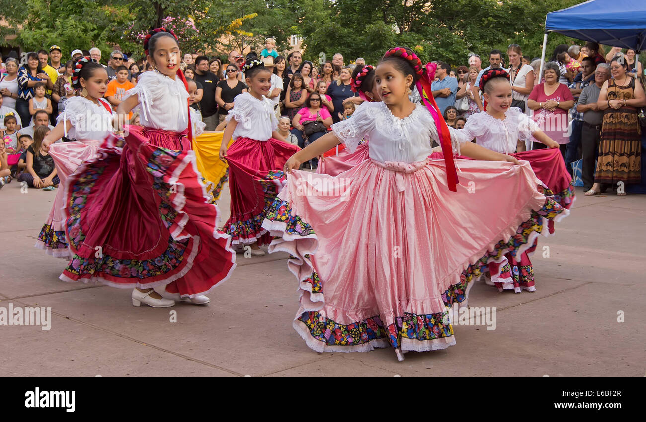 Hispanic folkloric dance group performing in Santa Fe, New Mexico, during Bandstand 2014, a celebration of music - Stock Image