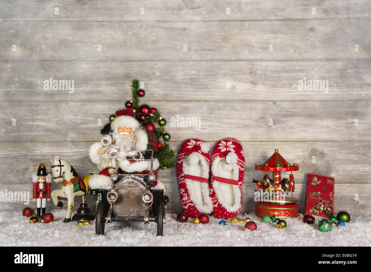 Wooden Witty Vintage Christmas Background With Santa And Old Toys For Children In Country Style