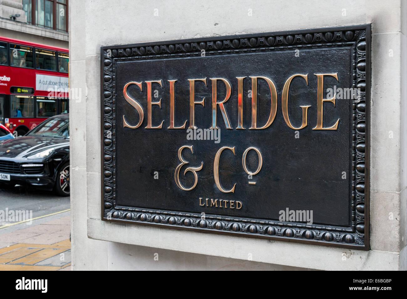 Selfridge & Co plaque on the corner of Selfridges, Oxford Street, London - Stock Image