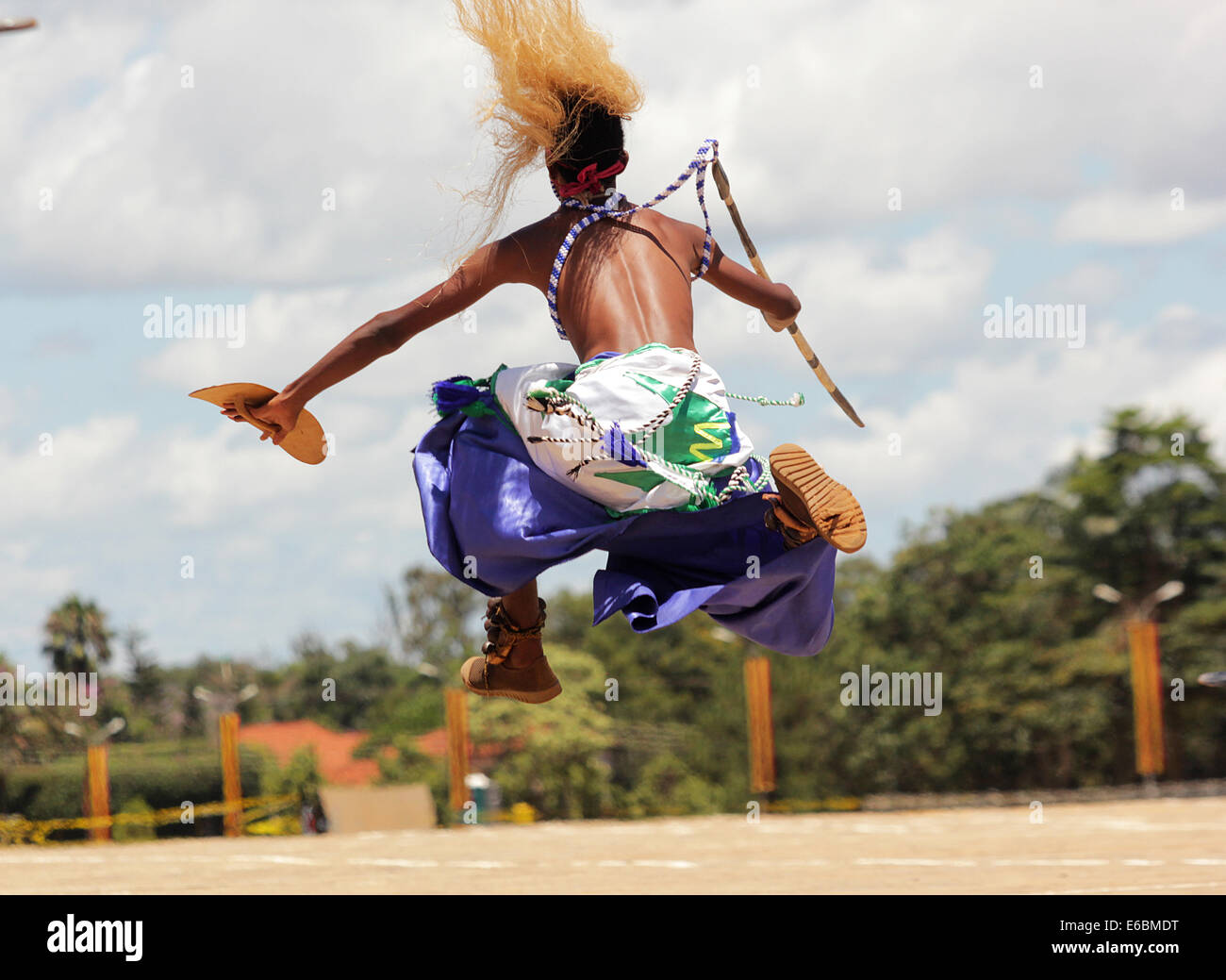 A member of the Burundi cultural troupe entertains guests in Kampala, Uganda - Stock Image