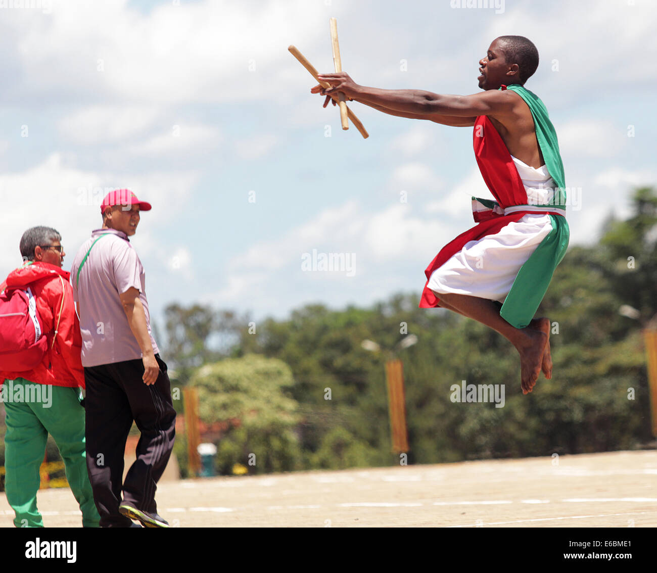 A member of a Burundi cultural dance troupe entertains guests in Kampala, Uganda - Stock Image