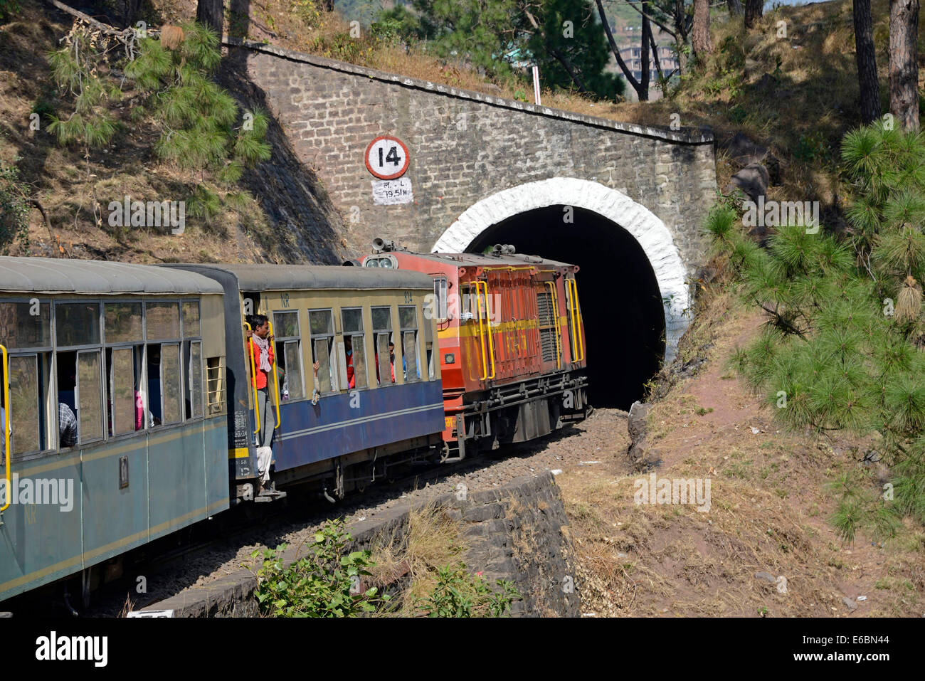The Himalayan Queen train enters  one of the 107 tunnels as it trundles along on the Kalka-Shimla 96 km long line - Stock Image