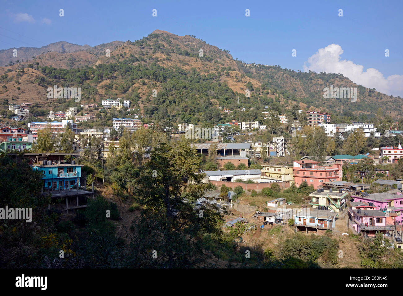 A small town in the Himalayan foothills from the Himalayan Queen train as it  trundles along on the Kalka -Shimla - Stock Image