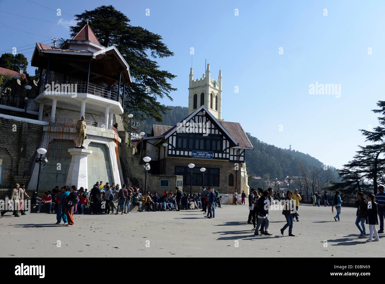 Visitors on the Ridge with Christ Church tower and the Tudor styled Shilam public library in Shimla ,Himachal Pradesh,India - Stock Image