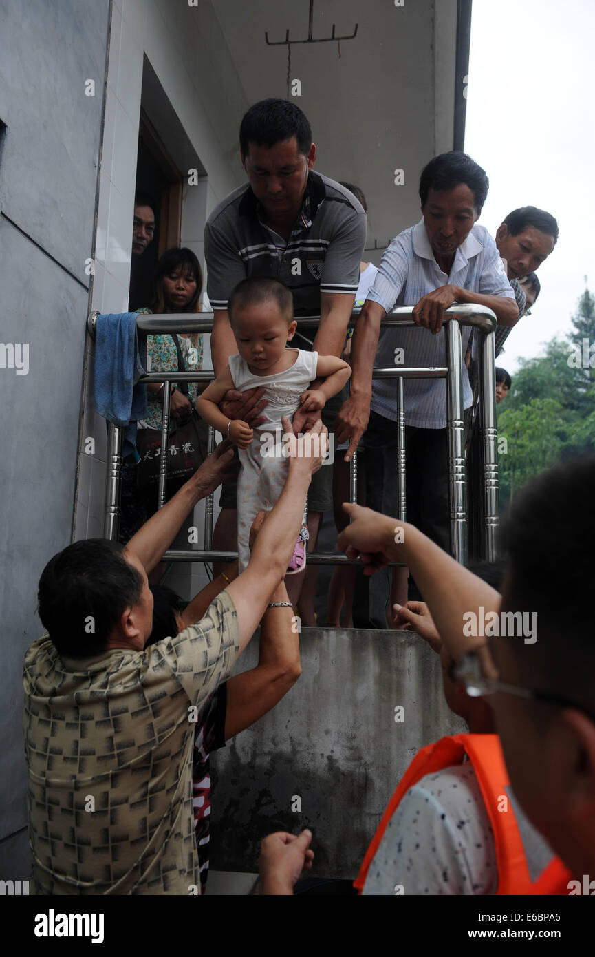 Lishui, China's Zhejiang Province. 20th Aug, 2014. Residents are evacuated as rain-triggered flood hit Lishui - Stock Image