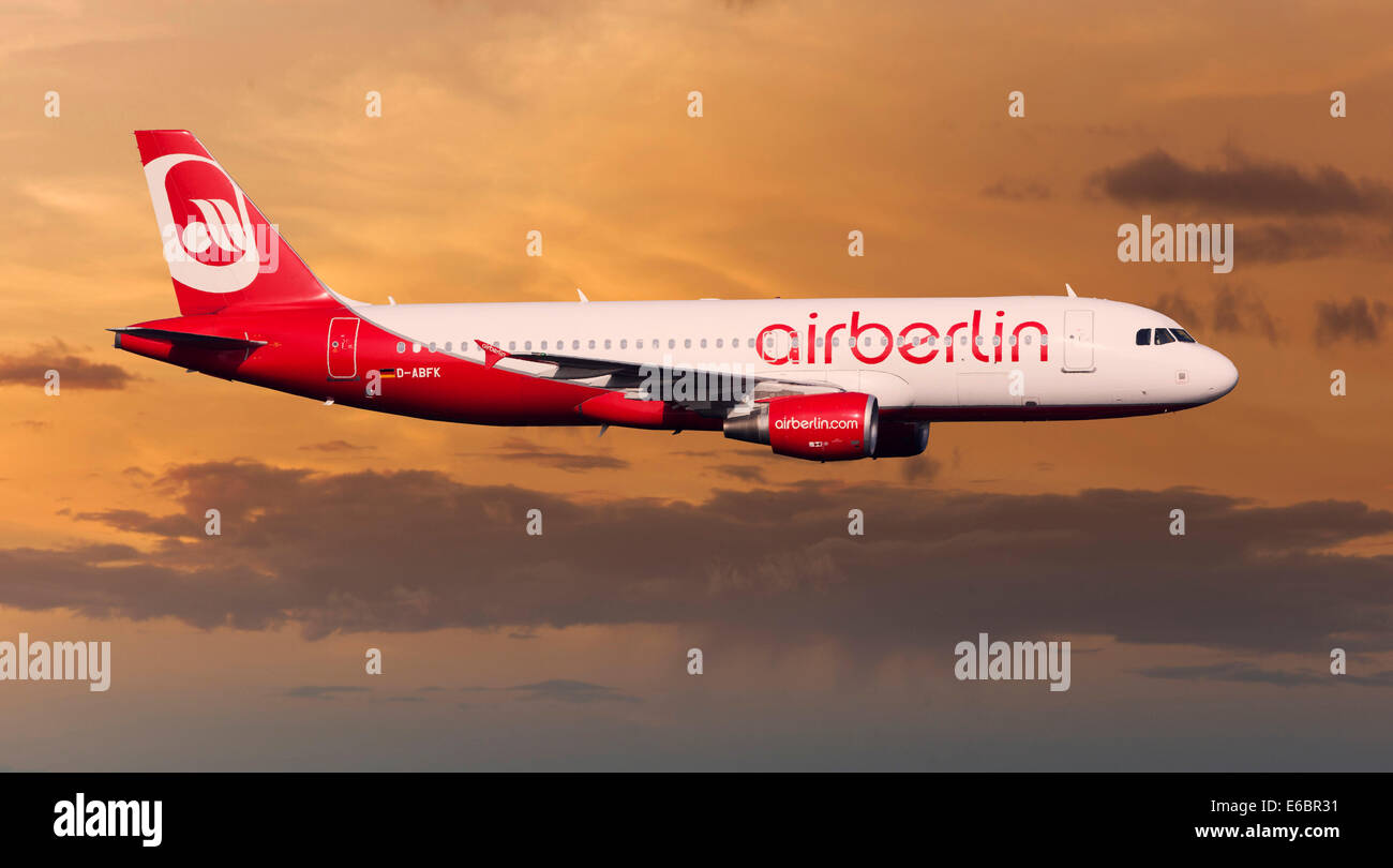 Air Berlin Airbus A320-214 in flight at night - Stock Image