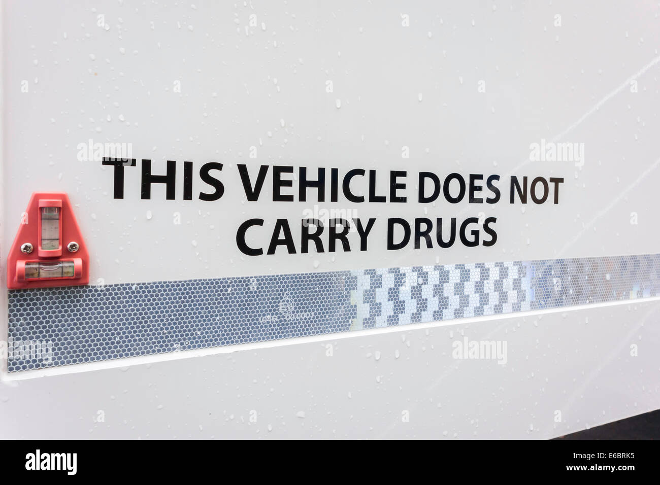 Notice on a National Health Service vehicle: This vehicle does not carry drugs - Stock Image
