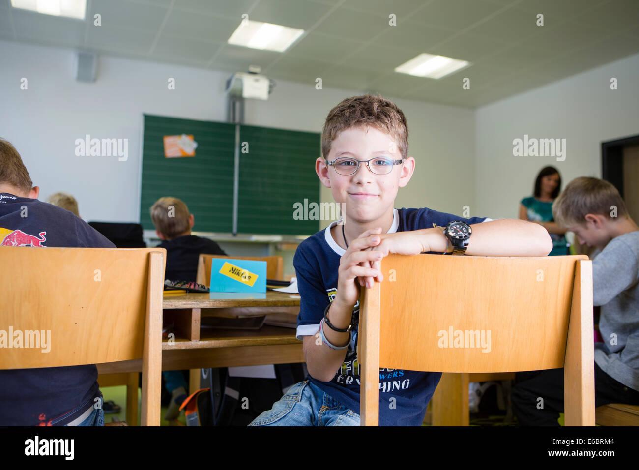 Boy in an elementary school class, Reith im Alpbachtal, Kufstein district, Tyrol, Austria - Stock Image