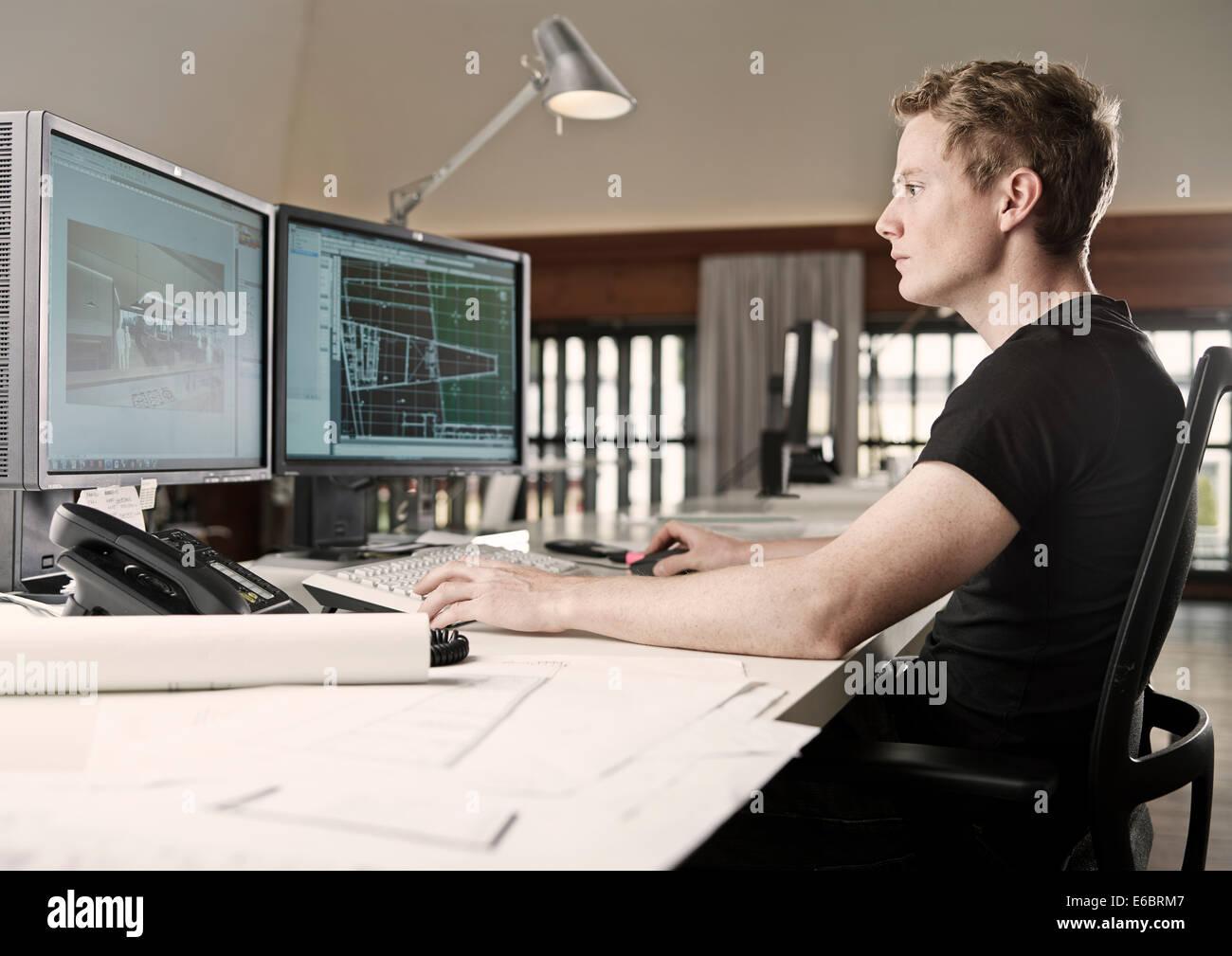 Architect planning on a computer, Innsbruck, Tyrol, Austria - Stock Image