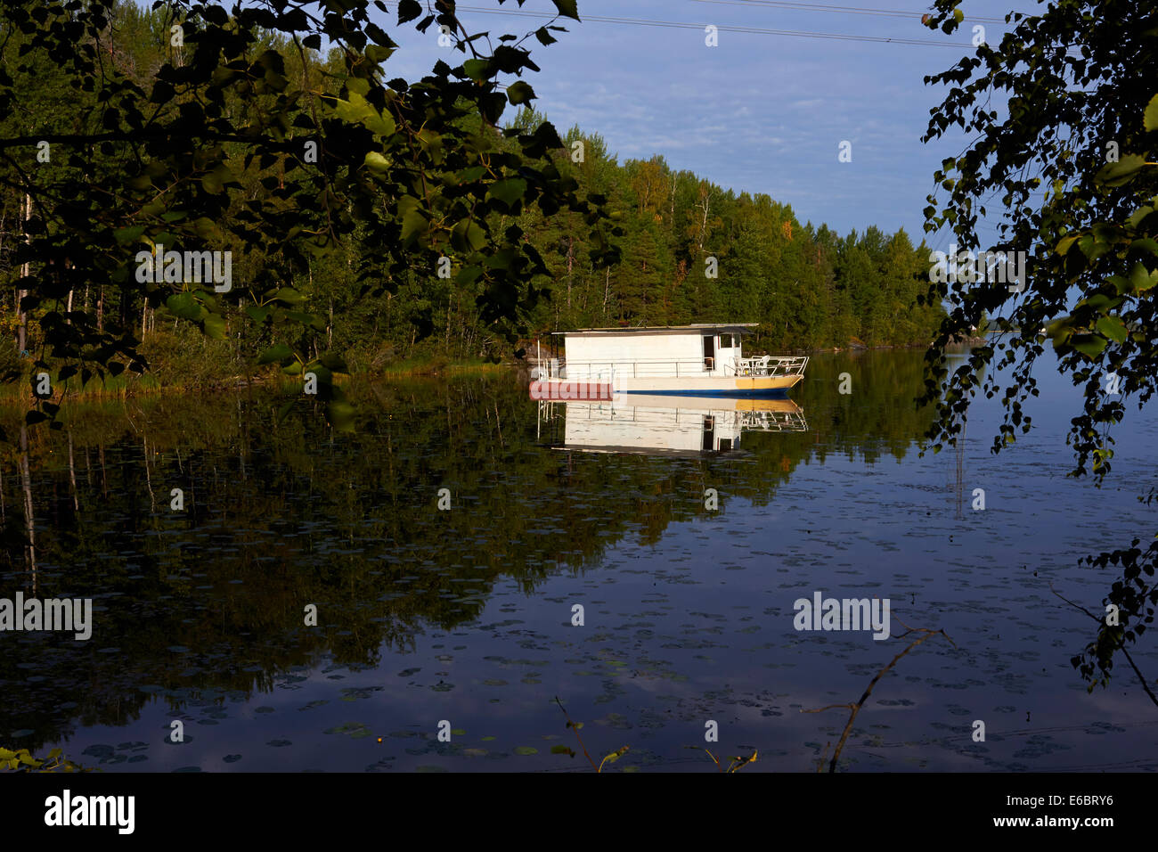 anchored house boat in Lappeenranta Finland - Stock Image