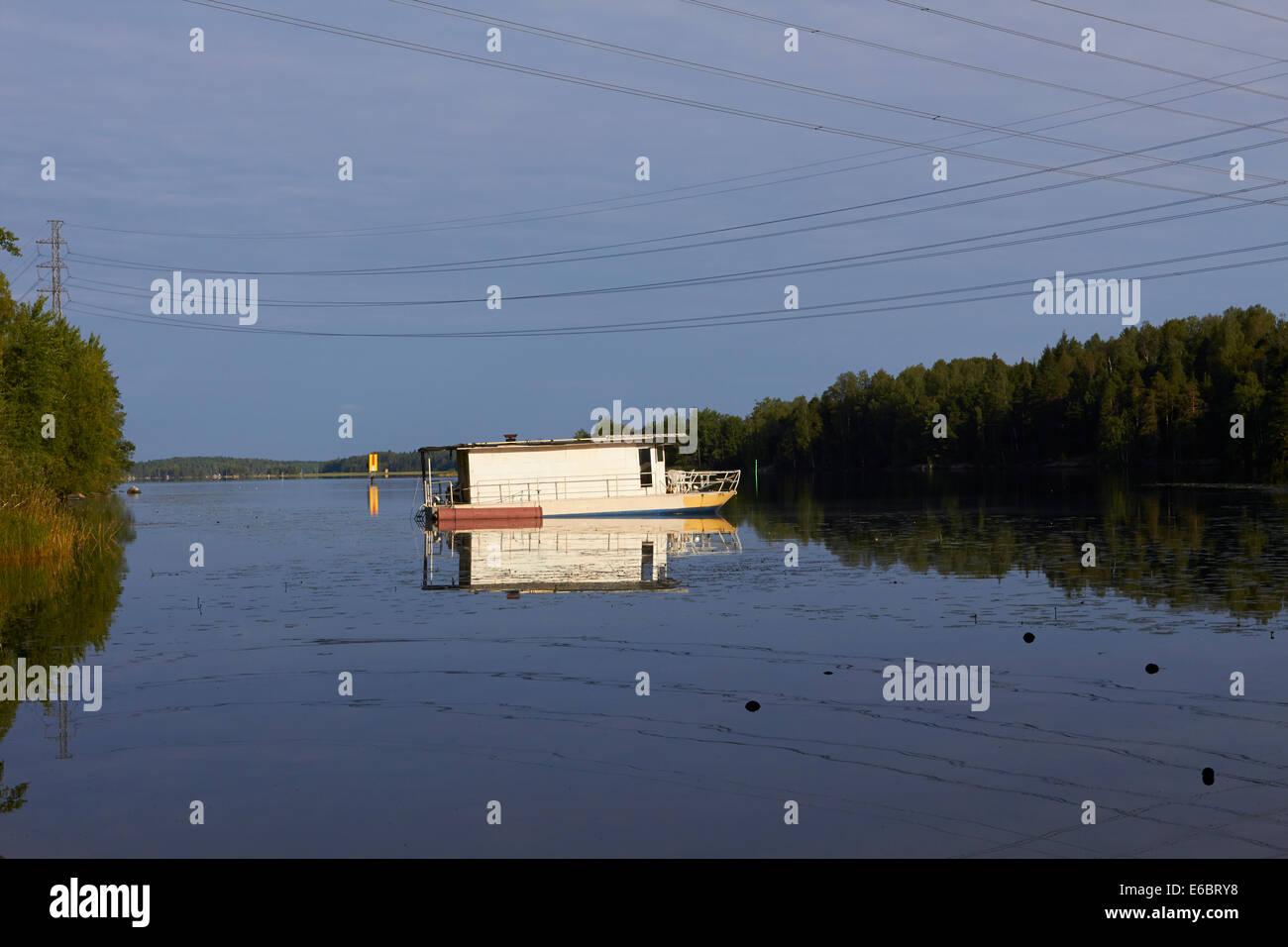 anchored house boat in Lappeenranta Finland - Stock Image
