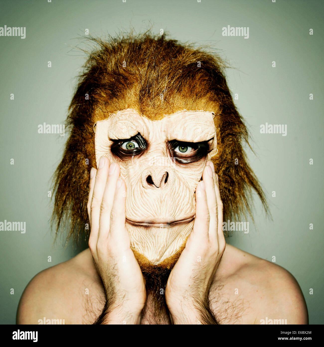 man,humor,bizarre,gorilla,monkey mask Stock Photo