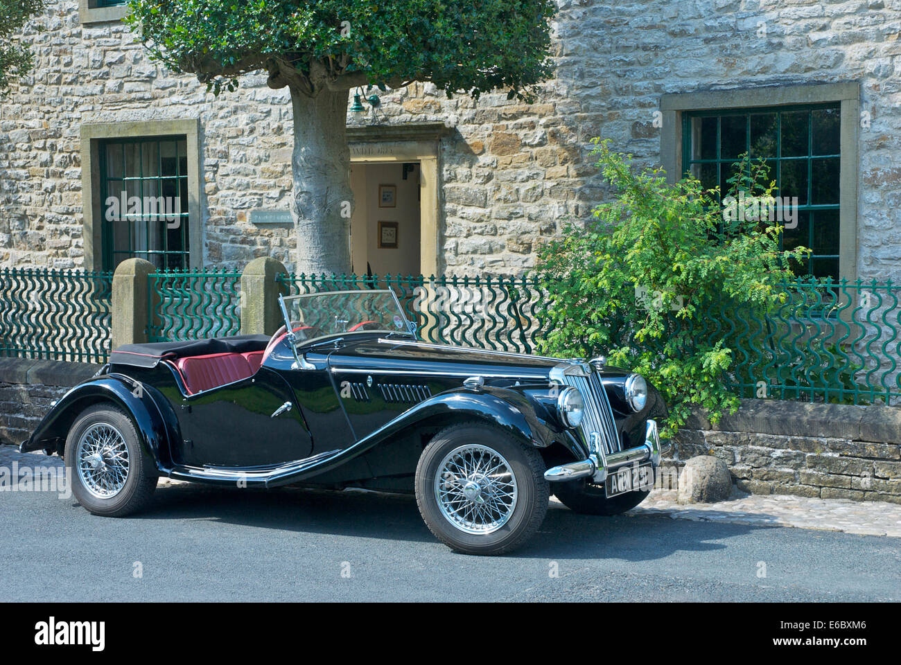 Convertible MG sports car parked outside cottage in the village of Kettlewell, Wharfedale, Yorkshire Dales Nat Park, - Stock Image