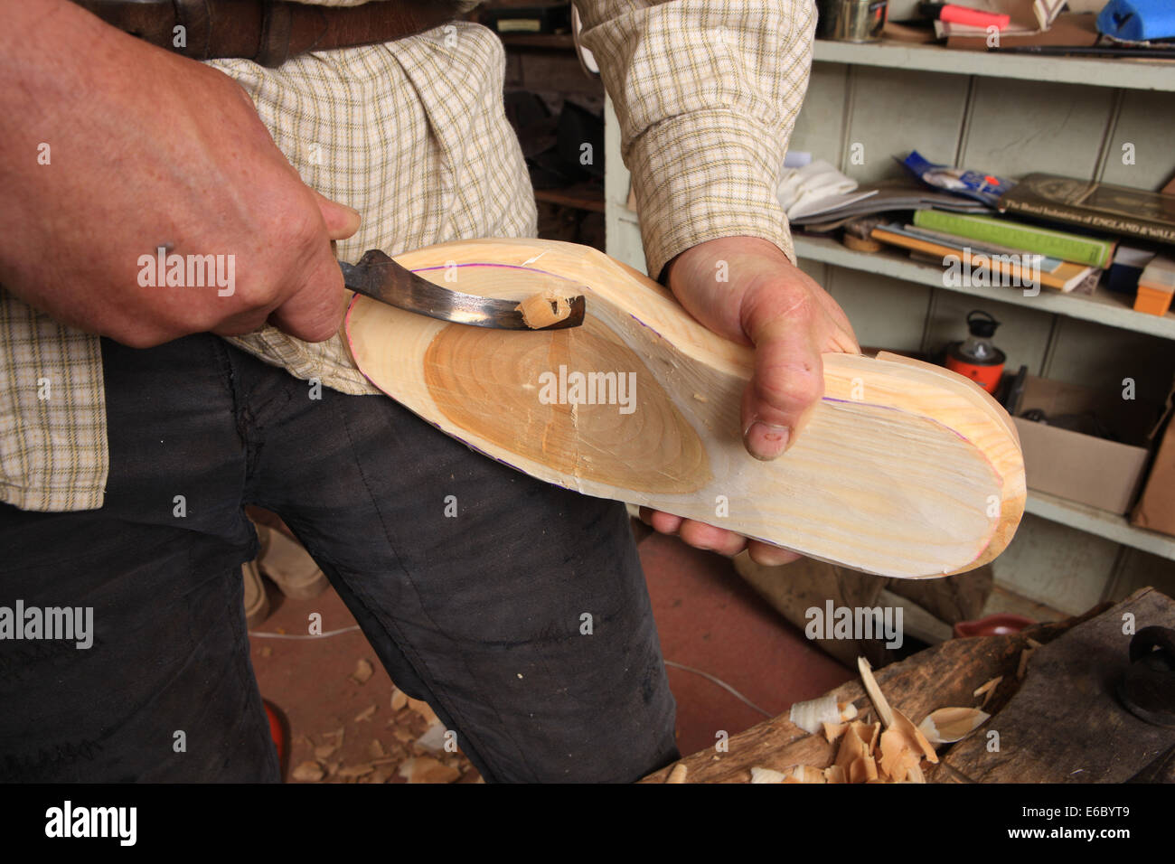 Jeremy Atkinson making Clogs in his workshop at Kington in Herefordshire ( Shaping a Billet of Wood ) - Stock Image