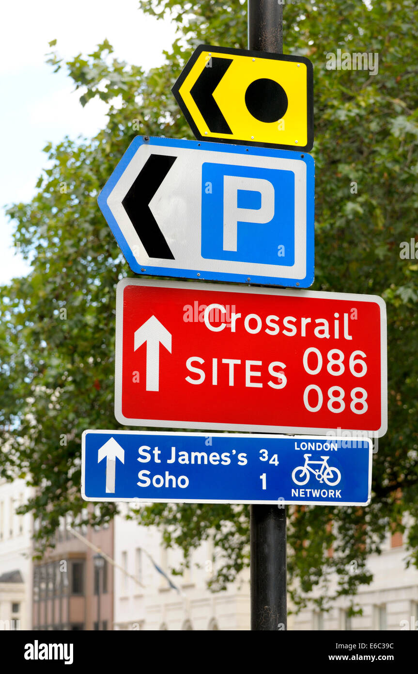 London, England, UK. Road signs in Grosvenor Square: parking; crossrail sites; cycle routes; - Stock Image