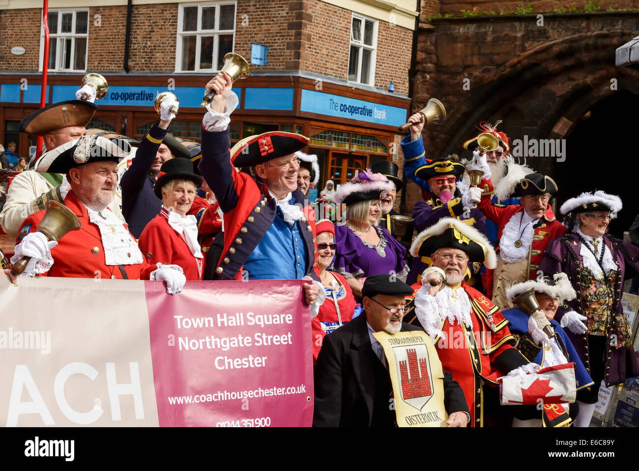 Chester, UK. 20th August, 2014. Entrants for The World Town Crier Tournament being held outside the Town Hall in - Stock Image