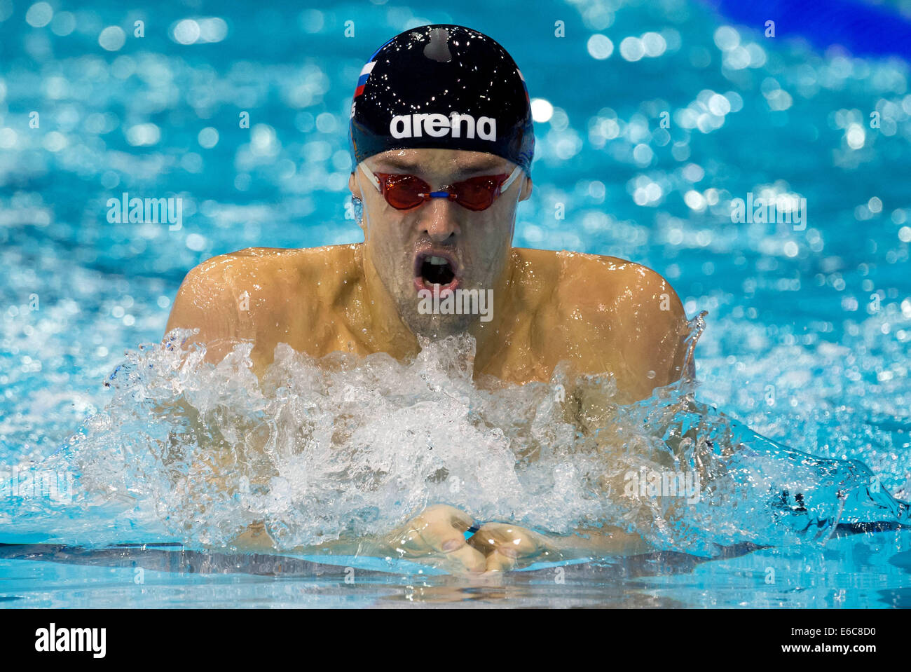 Berlin, Germany. 20th Aug, 2014. Grigory Falko from Russia competes in the mens 200m breaststroke preliminary at - Stock Image