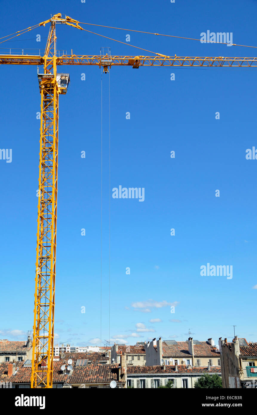Tall crane on a construction site, building site - Stock Image