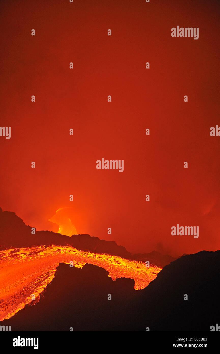 River of molten lava flowing to the sea, Kilauea Volcano, Big Island, Hawaii Islands, USA - Stock Image
