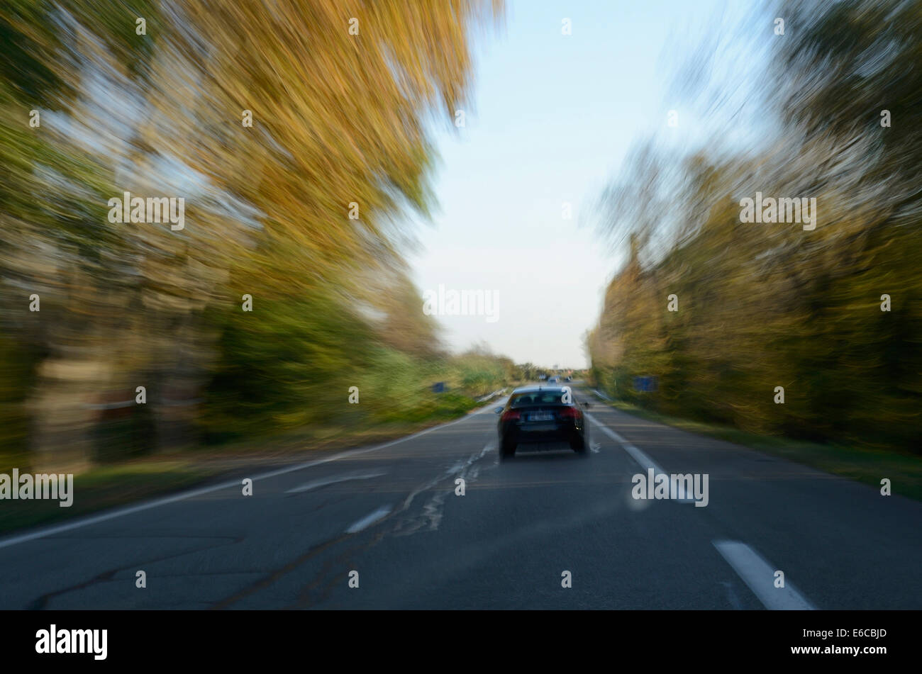 Car driving on a country road - Stock Image