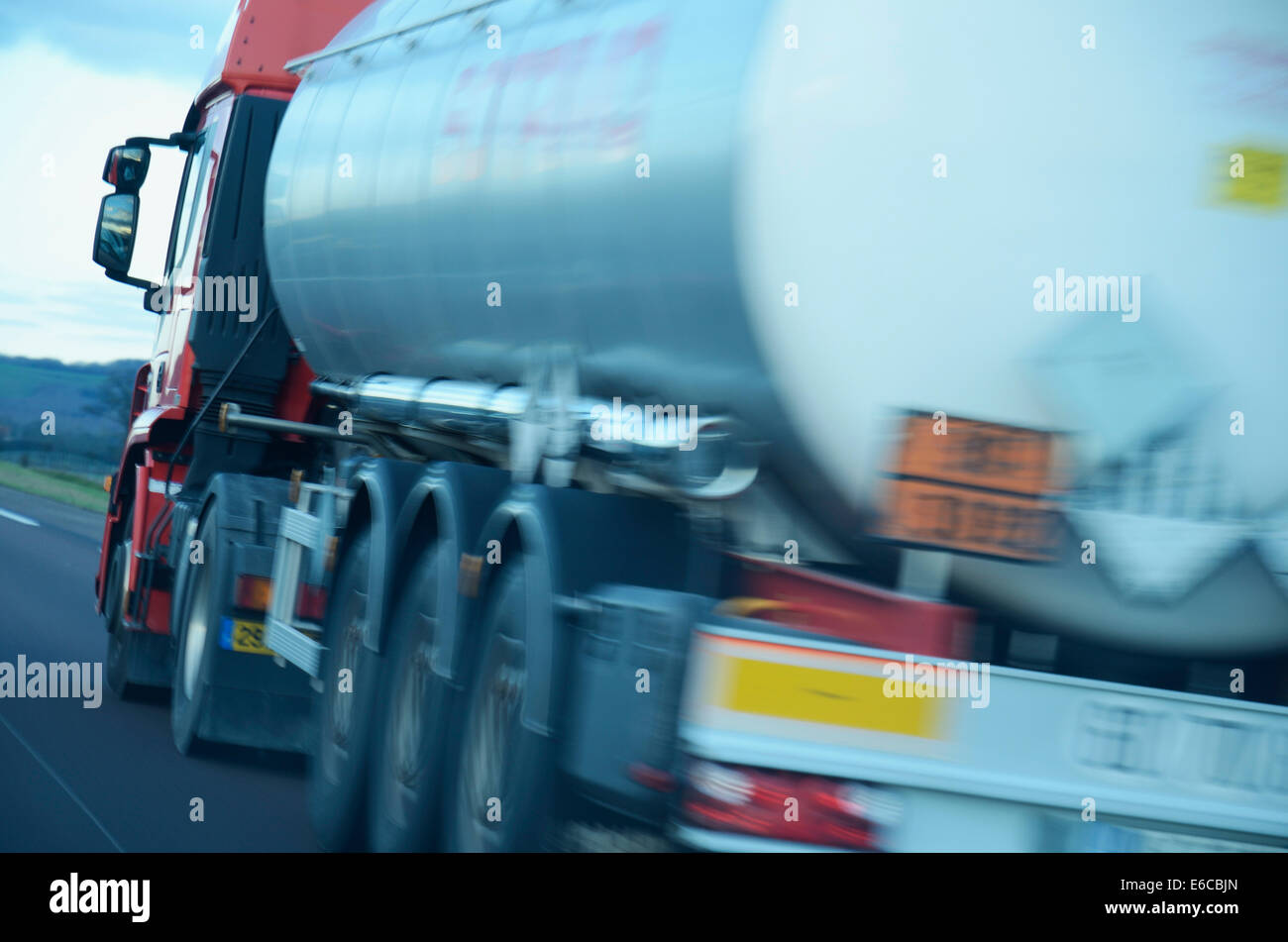 Speeding truck lorry driving on a motorway, France - Stock Image
