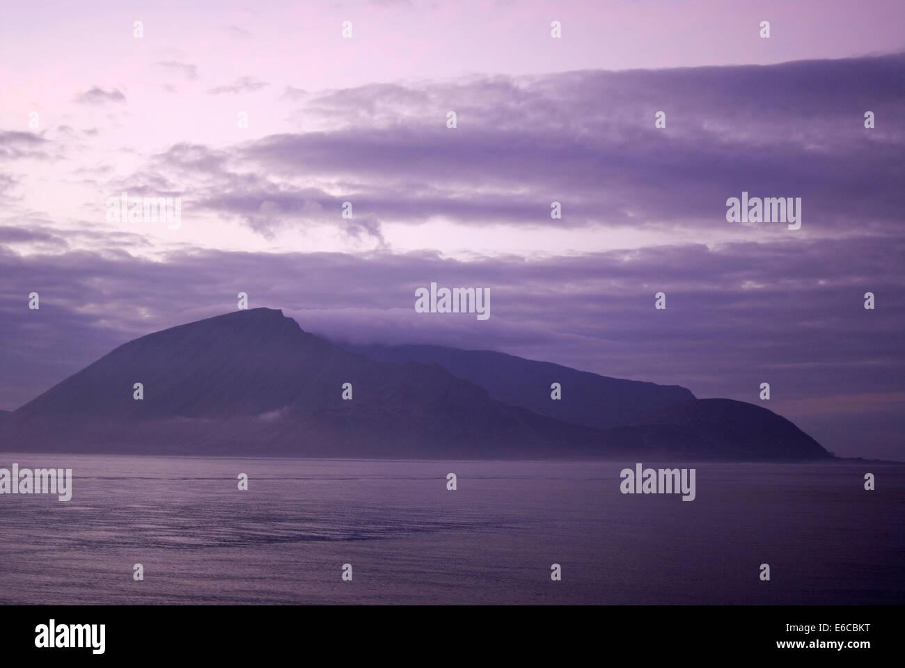 Sunrise on the volcanic island of Punta Vicente Roca / Isabela Island, Galapagos Islands, Ecuador, South America - Stock Image