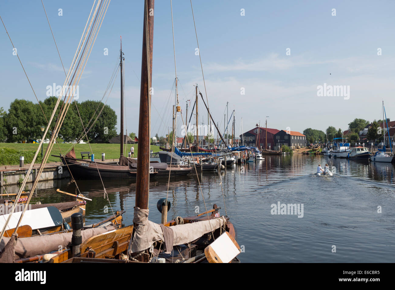 Harbor of Elburg, an old  Hanseatic city in the Netherlands, with old wooden fishing boats. - Stock Image