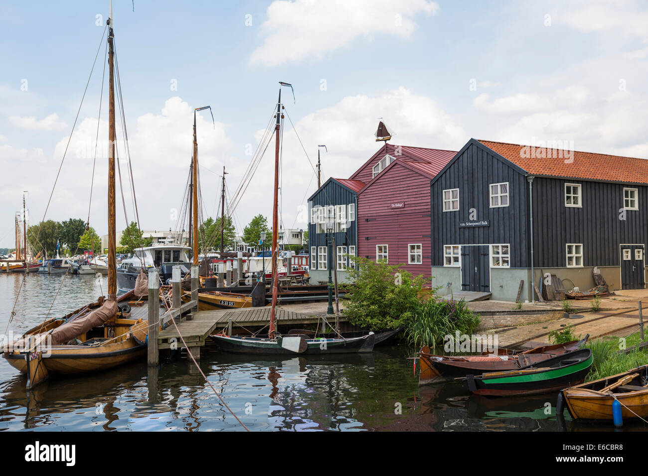 Harbor of Elburg, an old historical Hanseatic city in the Netherlands, with old wooden fishing boats. - Stock Image