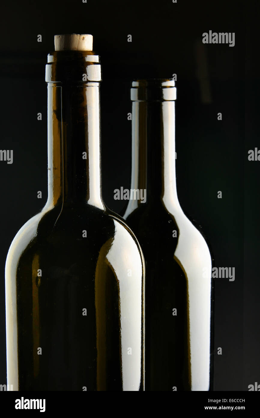 Necks of two bottles over black background Stock Photo