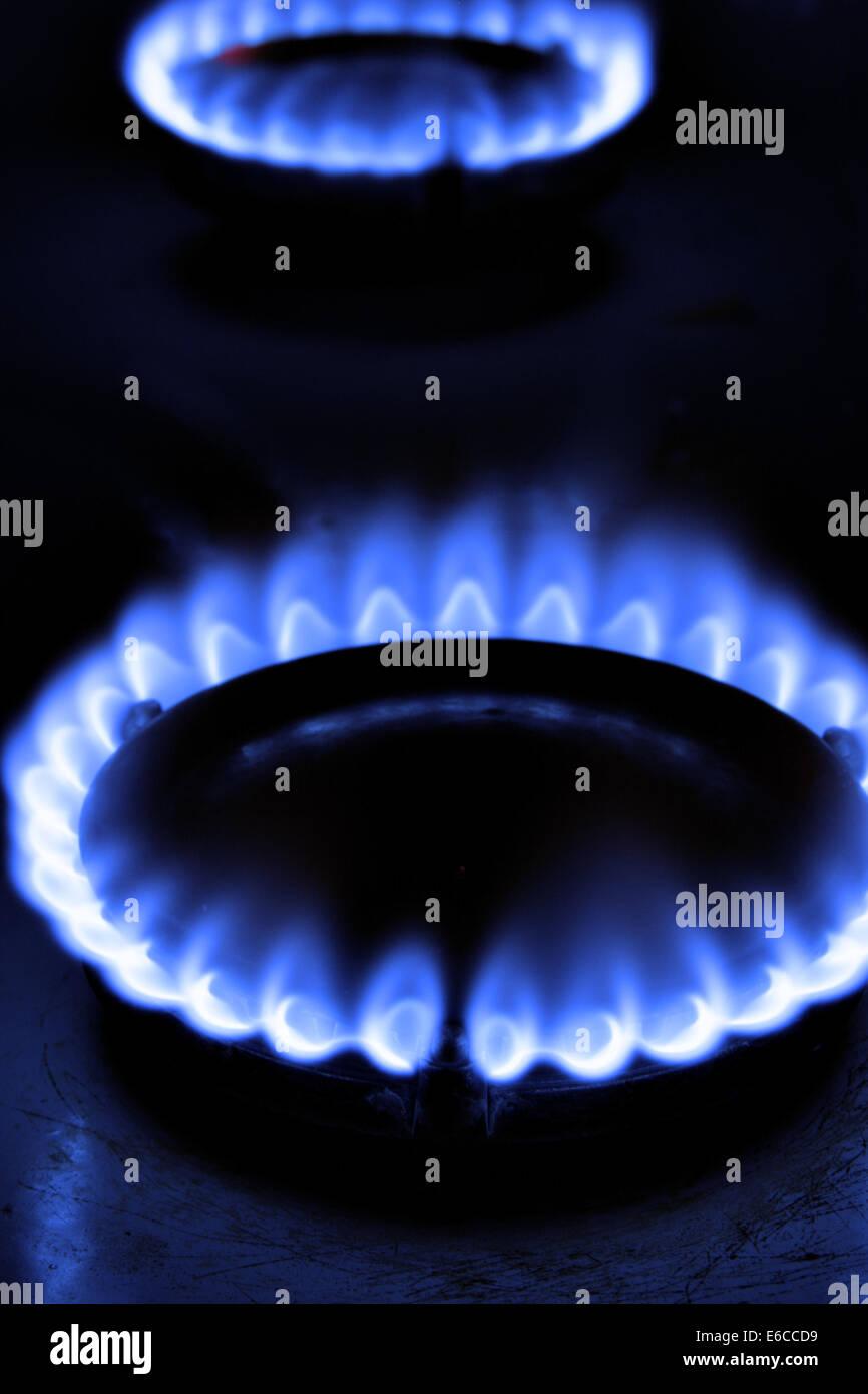 Gas flame on burner close-up over black background - Stock Image