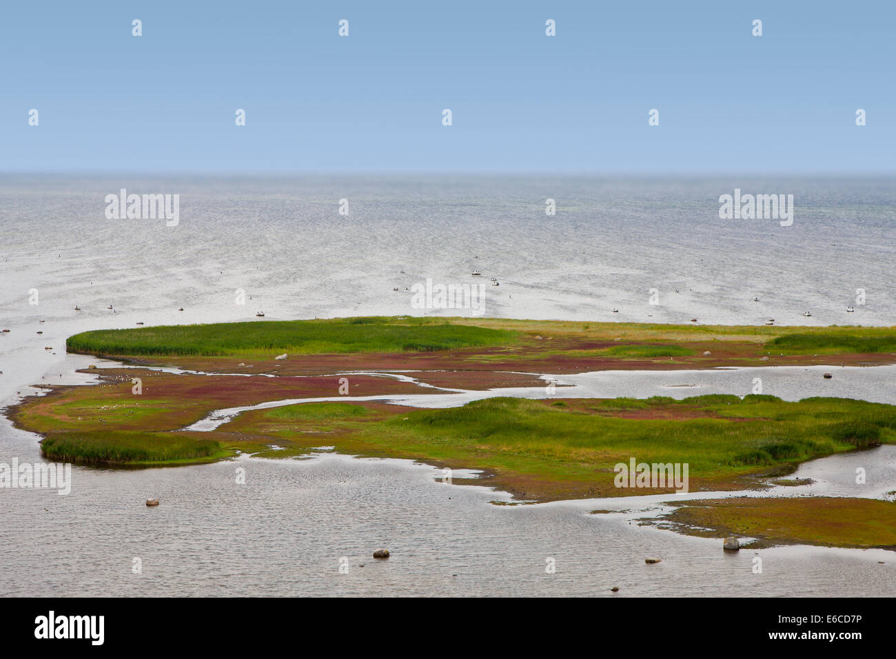 Flat grass covered Island - Stock Image