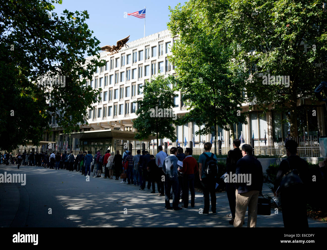 Queue for security check at U.S. Embassy in Grosvenor Square, Mayfair, London - Stock Image