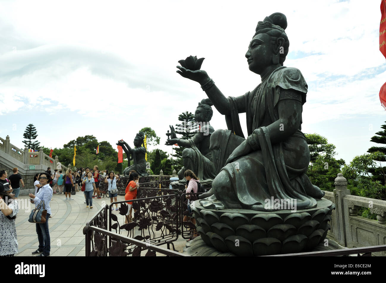 Three of the six Divas known as 'The offering of the six Divas'; bronze statues at the Tian Tan Buddha, - Stock Image