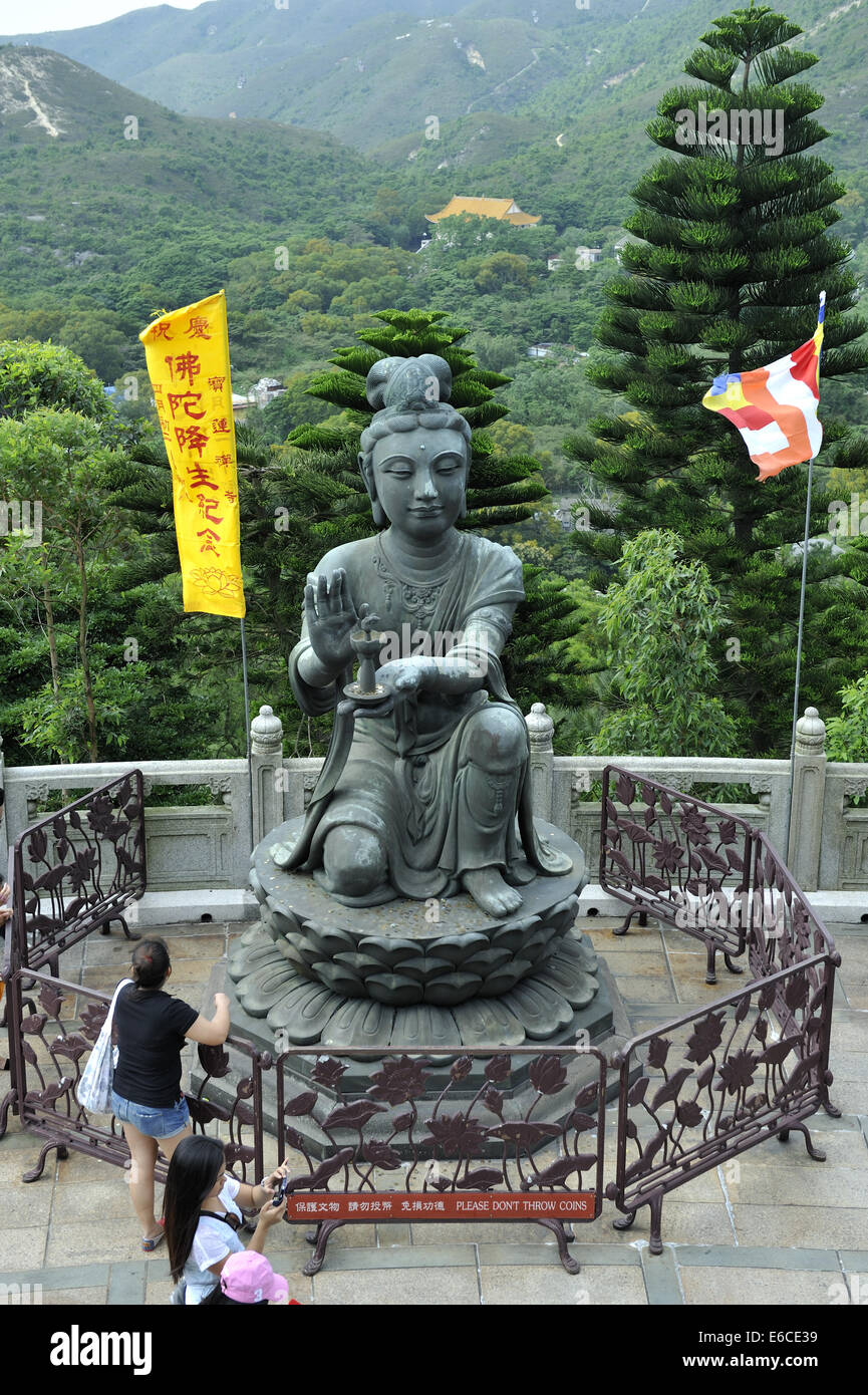 One of the six Divas known as 'The offering of the six Divas'; bronze statues at the Tian Tan Buddha, Lantau - Stock Image