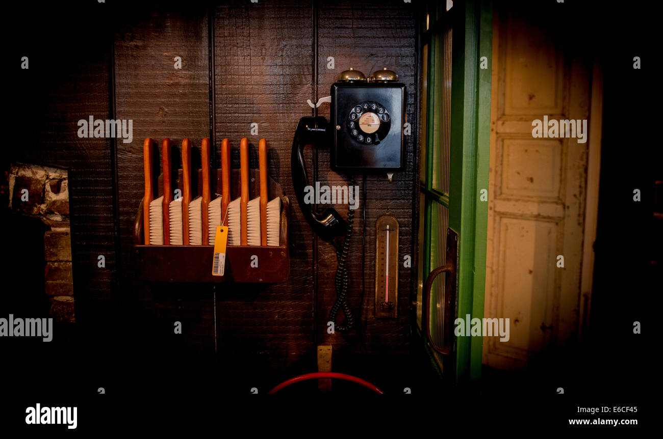 A telephone and clothes brushes at a popular Hastings old fashioned store set in a time-warp. - Stock Image