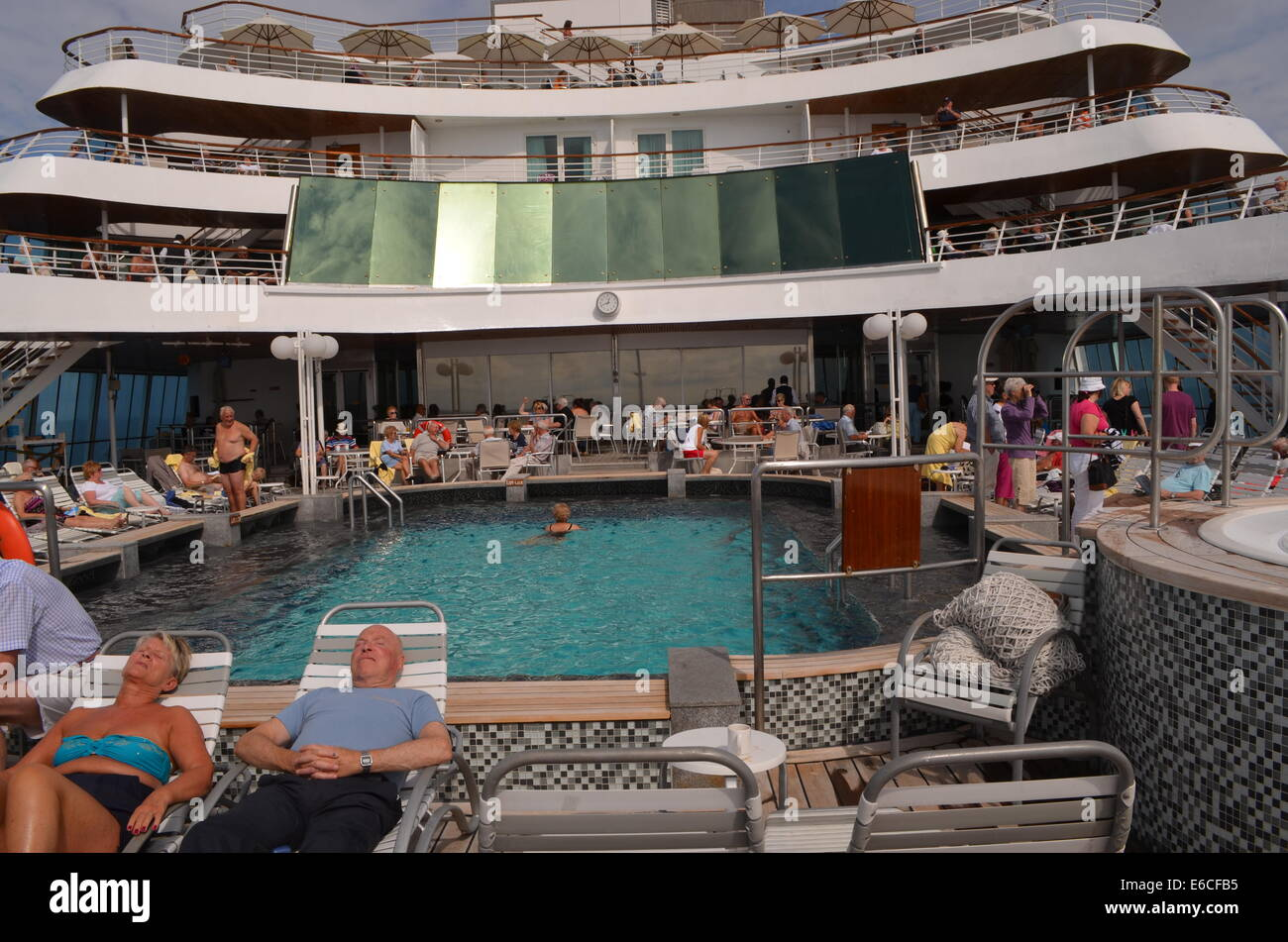 The swimming pool on board the SS Balmoral, on Fred Olsen ship departing Southampton to tour Norway. Some already Stock Photo