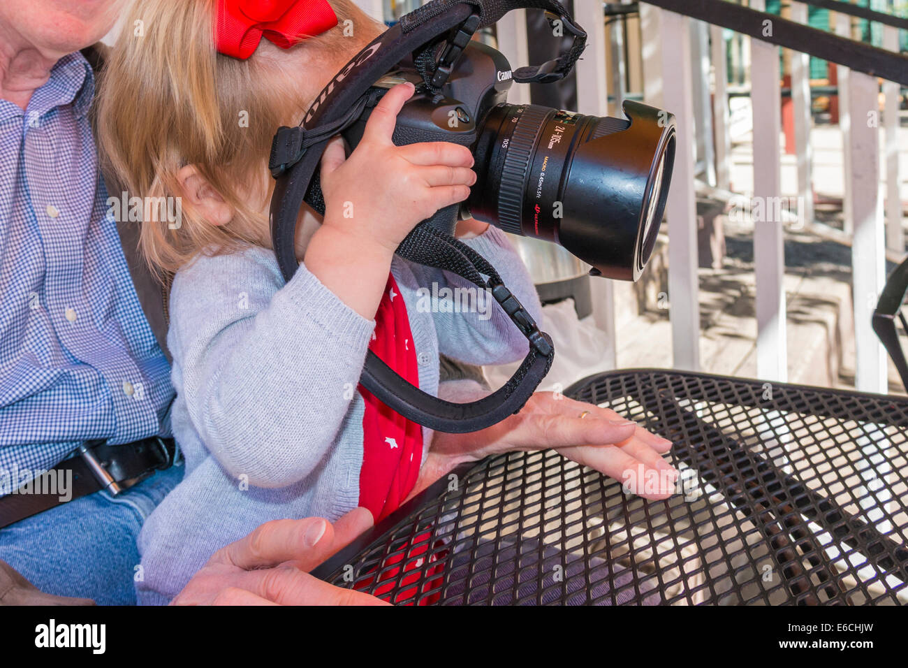 Little girl with a big camera. - Stock Image