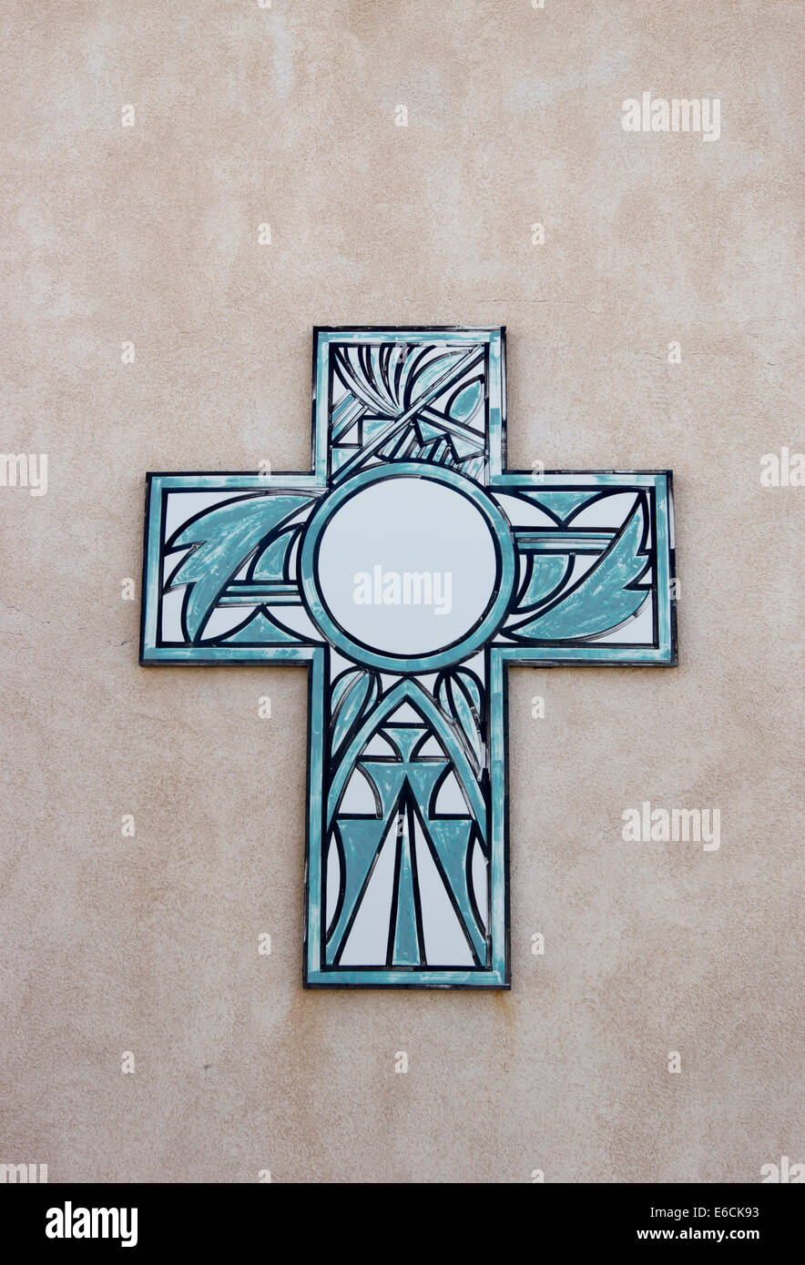 Cross adorning a wall of the historic Laguna Pueblo Mission in New Mexico - Stock Image