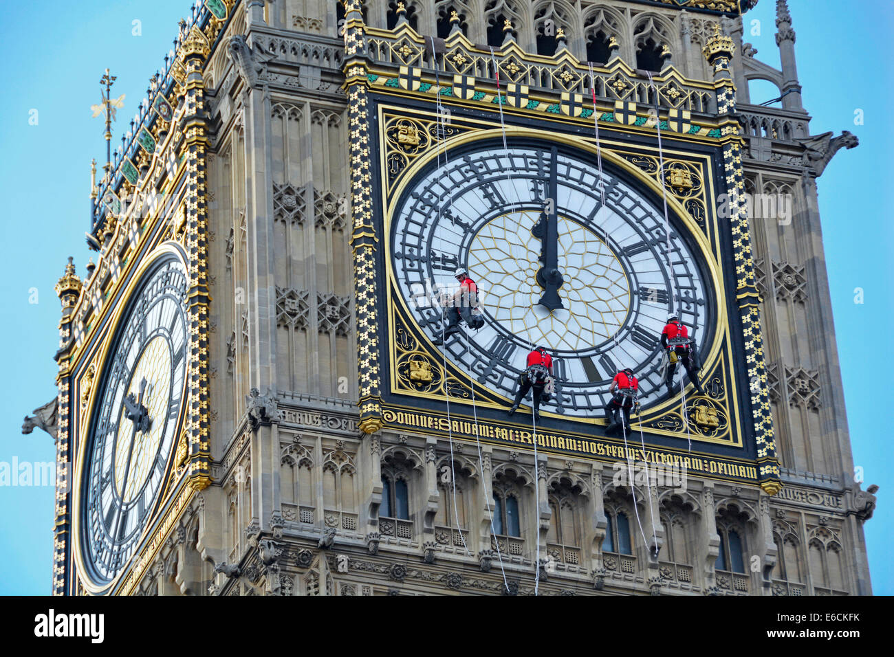 Big Ben Elizabeth Tower clock face being cleaned with hands set to wrong time of 12 noon or midnight Stock Photo