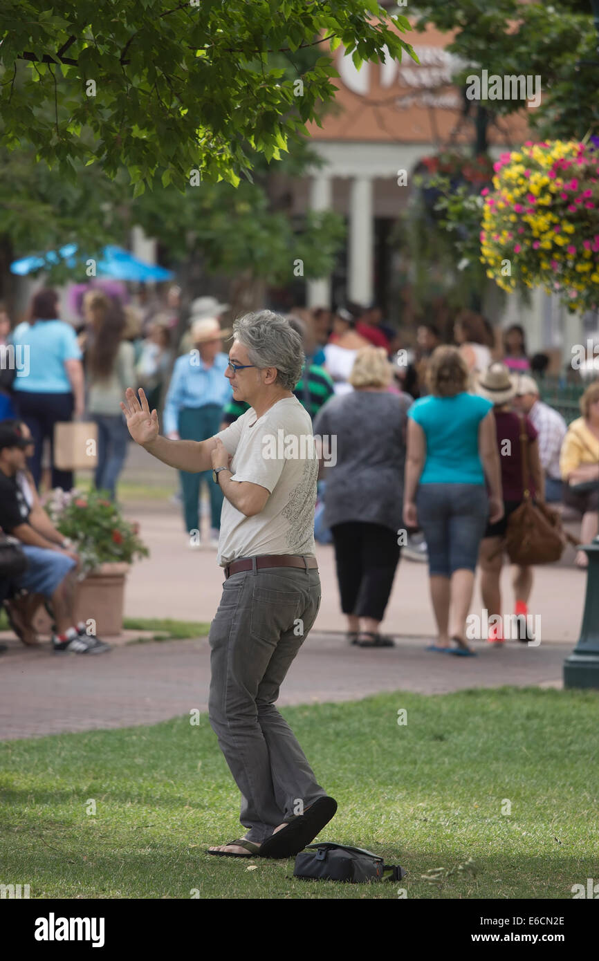 Man practicing Tai Chi in a park in Santa Fe, New Mexico. - Stock Image