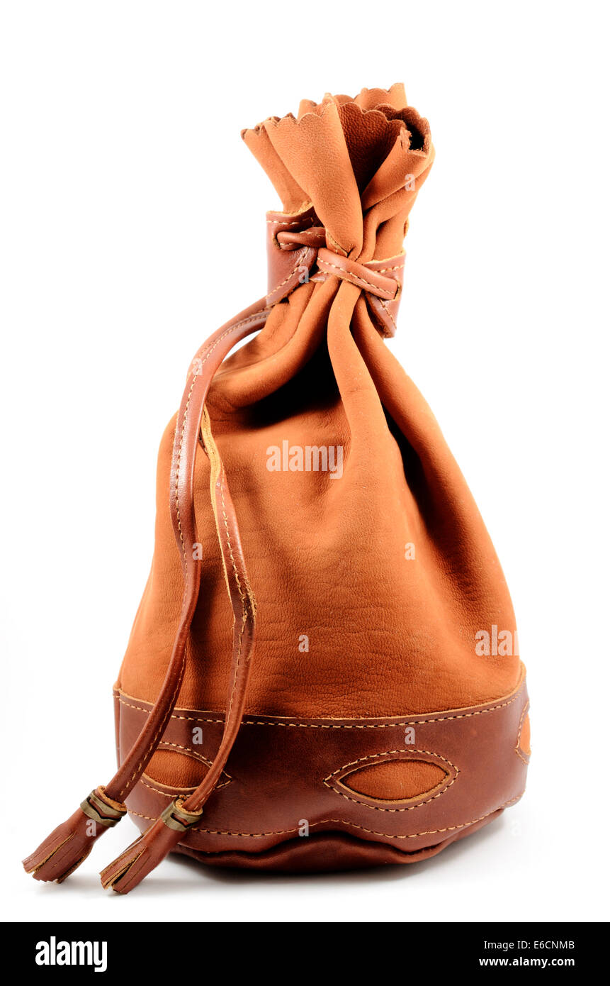 brown suede pouch on white background, vertical - Stock Image