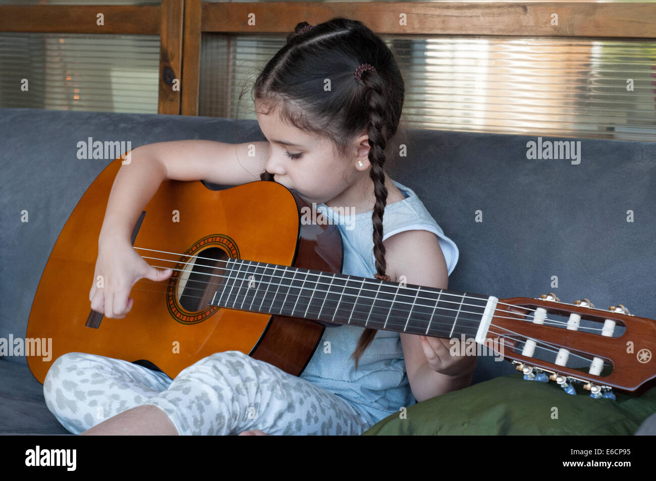 child playing guitar stock photos child playing guitar stock images alamy. Black Bedroom Furniture Sets. Home Design Ideas